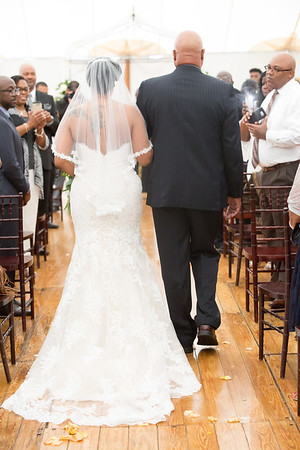 A guest's flash takes away from the bride and her father walking down the isle.