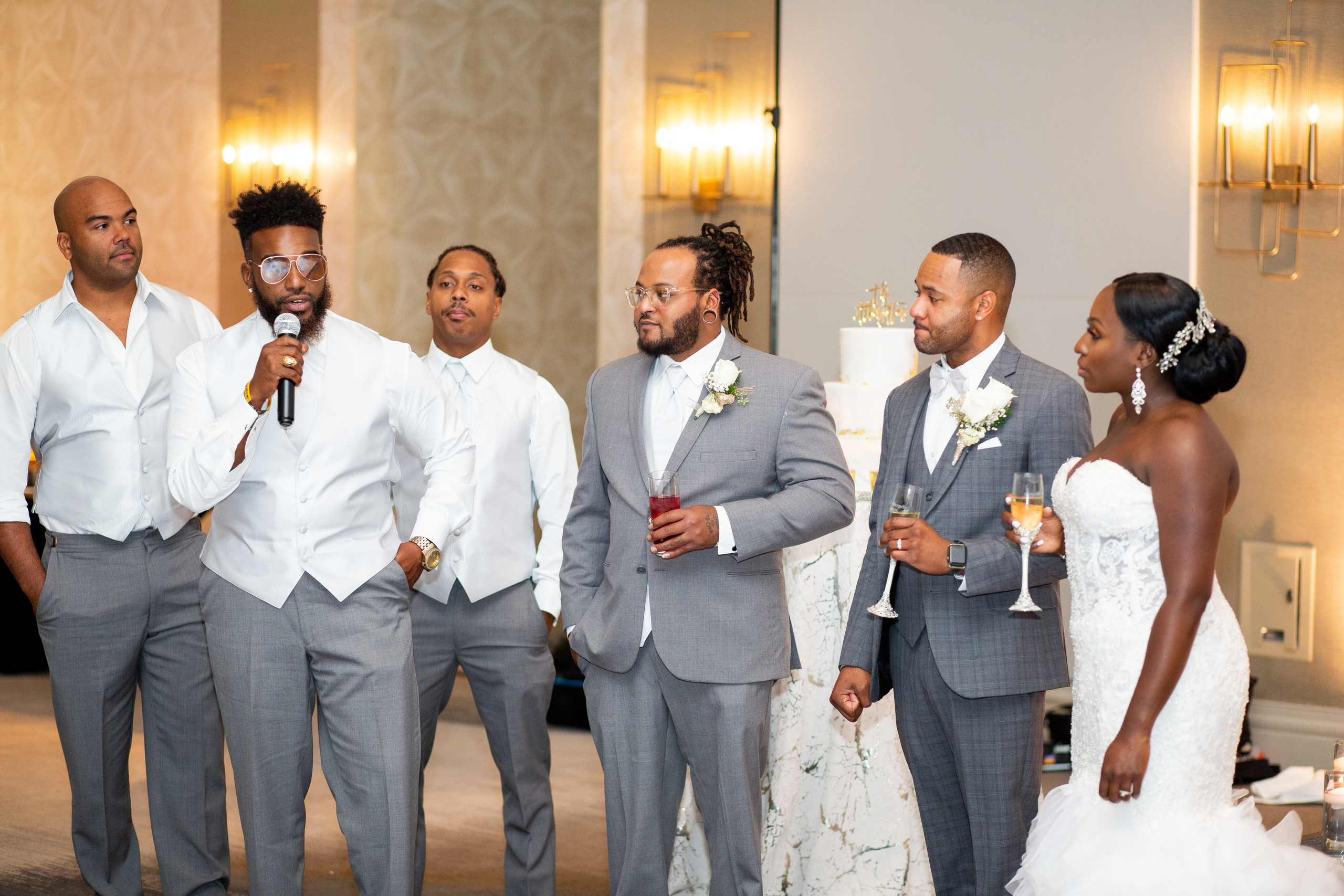 The groomsmen give their speech and toast the newlyweds during the wedding reception at the Hilton Main in Norfolk, Virginia.