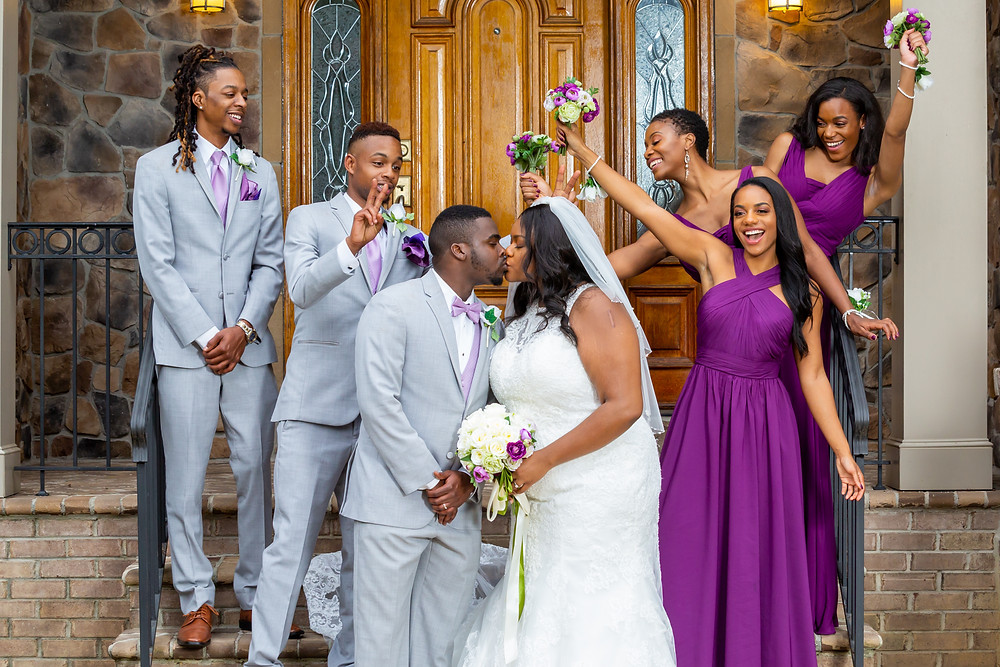 Jordyn and John share a fun moment with their wedding party after the ceremony in Fairfax, Virginia.