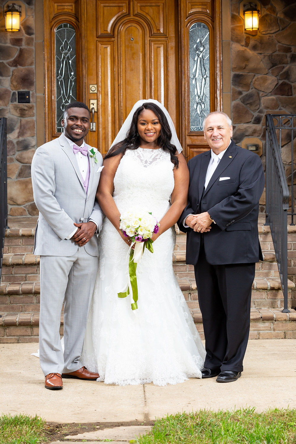 John and Jordyn posing with the pastor after the wedding ceremony in Fairfax, Virginia.