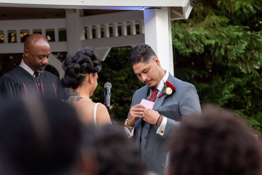 Groom stating vows during the wedding ceremony at Martin's Crosswinds in Greenbelt, Maryland.