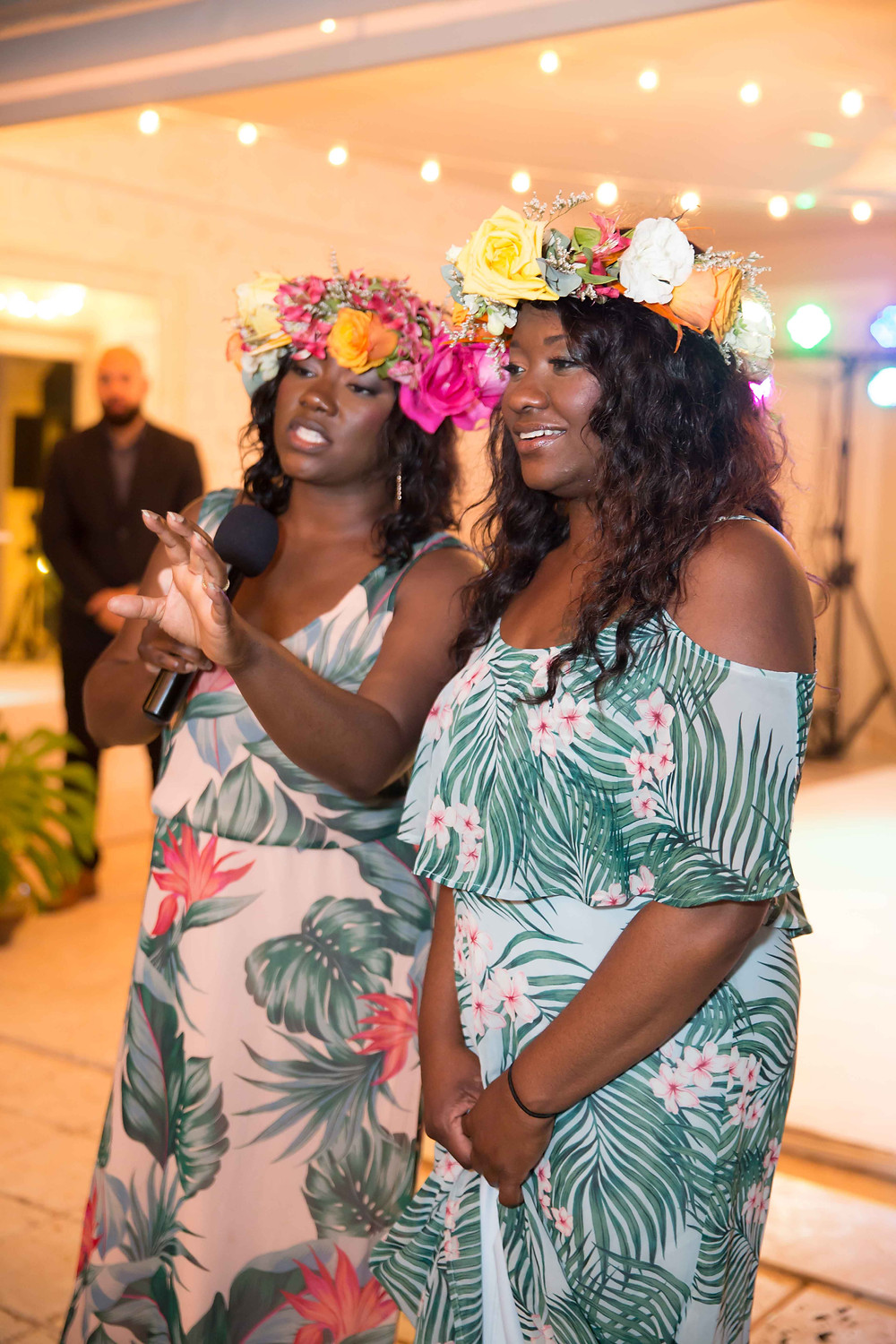 The bride's sisters speak at the destination wedding reception in Punta Cana, Dominican Repulic.