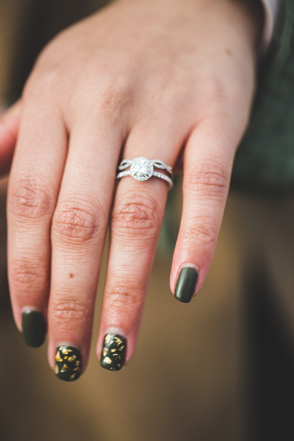Dakota showing off her engagement ring the day he proposed at the Jefferson Memorial in Washington DC.