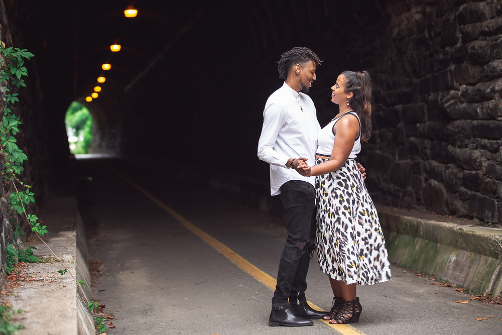 Couple dancing in the Wilkes Tunnel during their engagement session in Old Town Alexandria, Virginia.