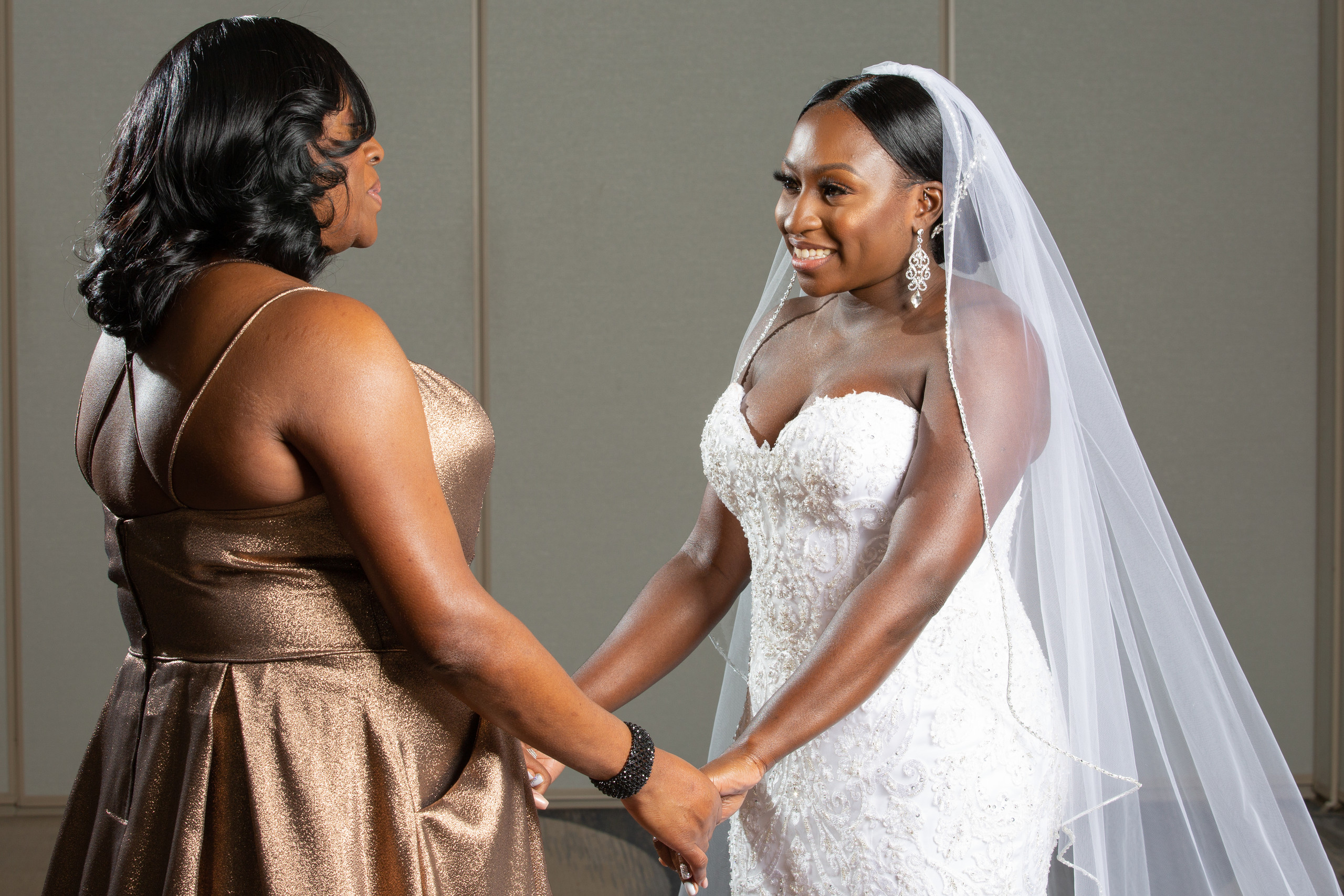 Bride with her mother before the wedding ceremony at the Hilton Main in Norfolk, Virginia.