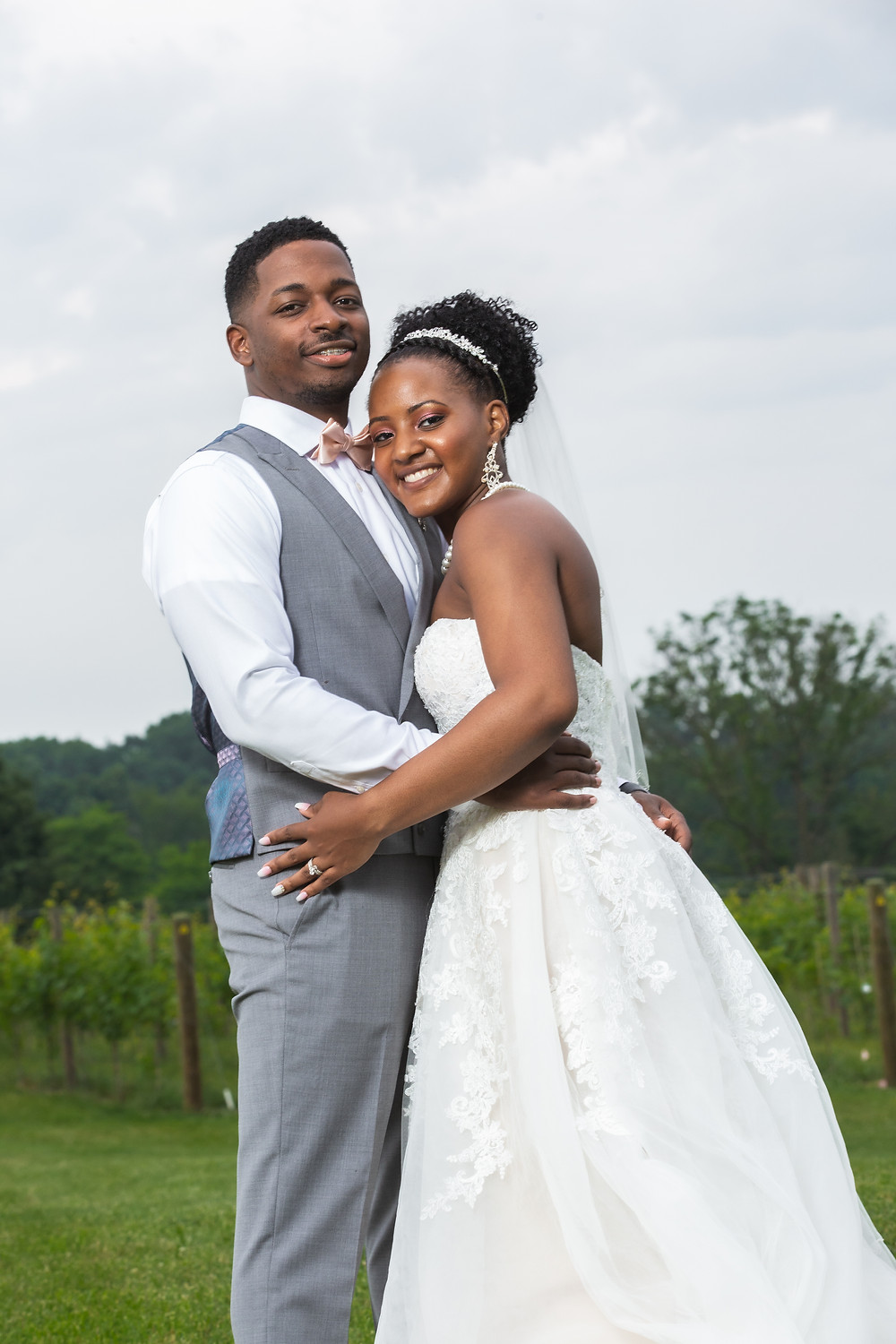 Demitra and Lance pose for a wedding portrait after their wedding ceremony at Crosskeys Vineyards in Mt. Crawford, Virginia.