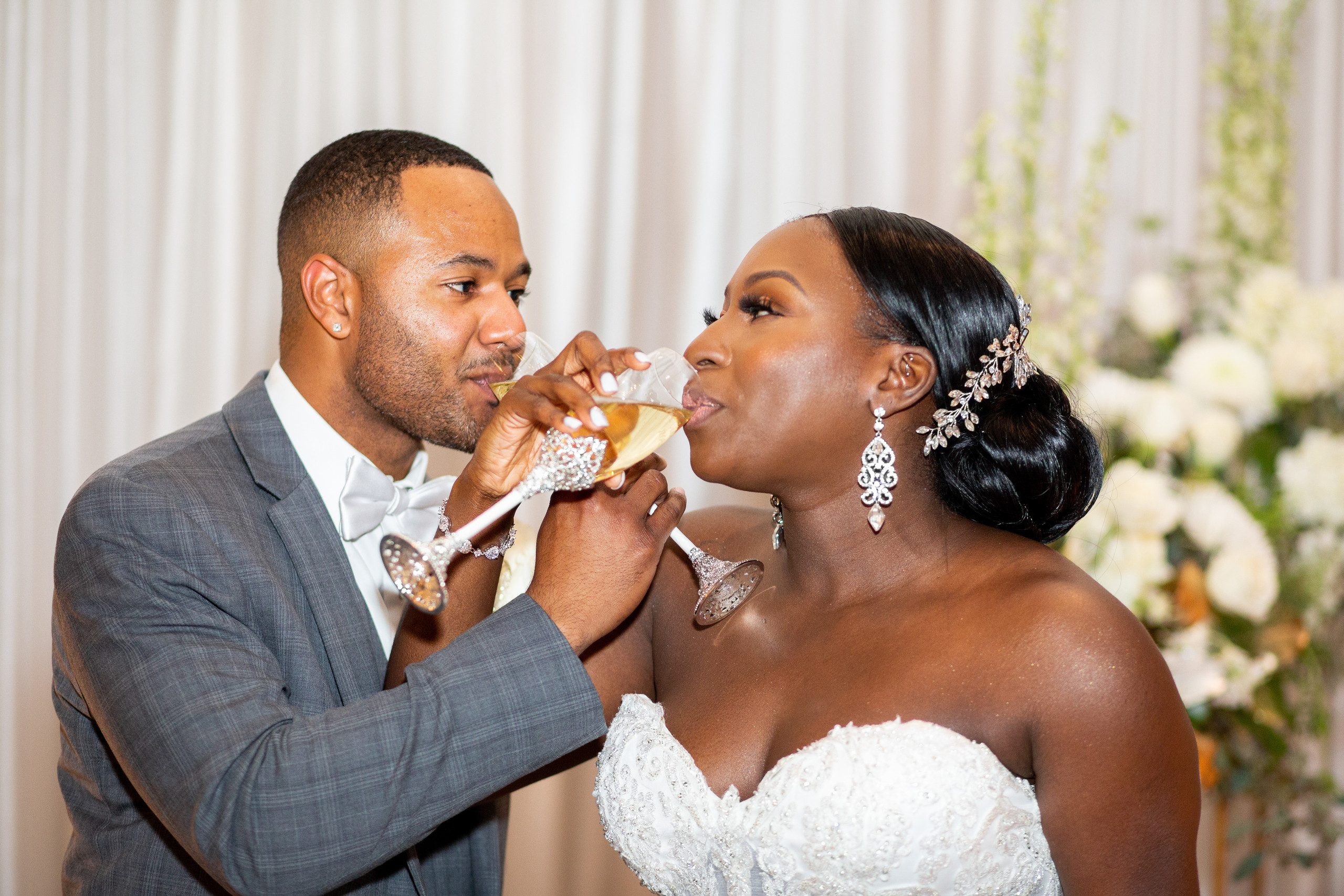 The bride and groom share a sip of champaigne during the wedding reception at the Hilton Main in Norfolk, Virginia.