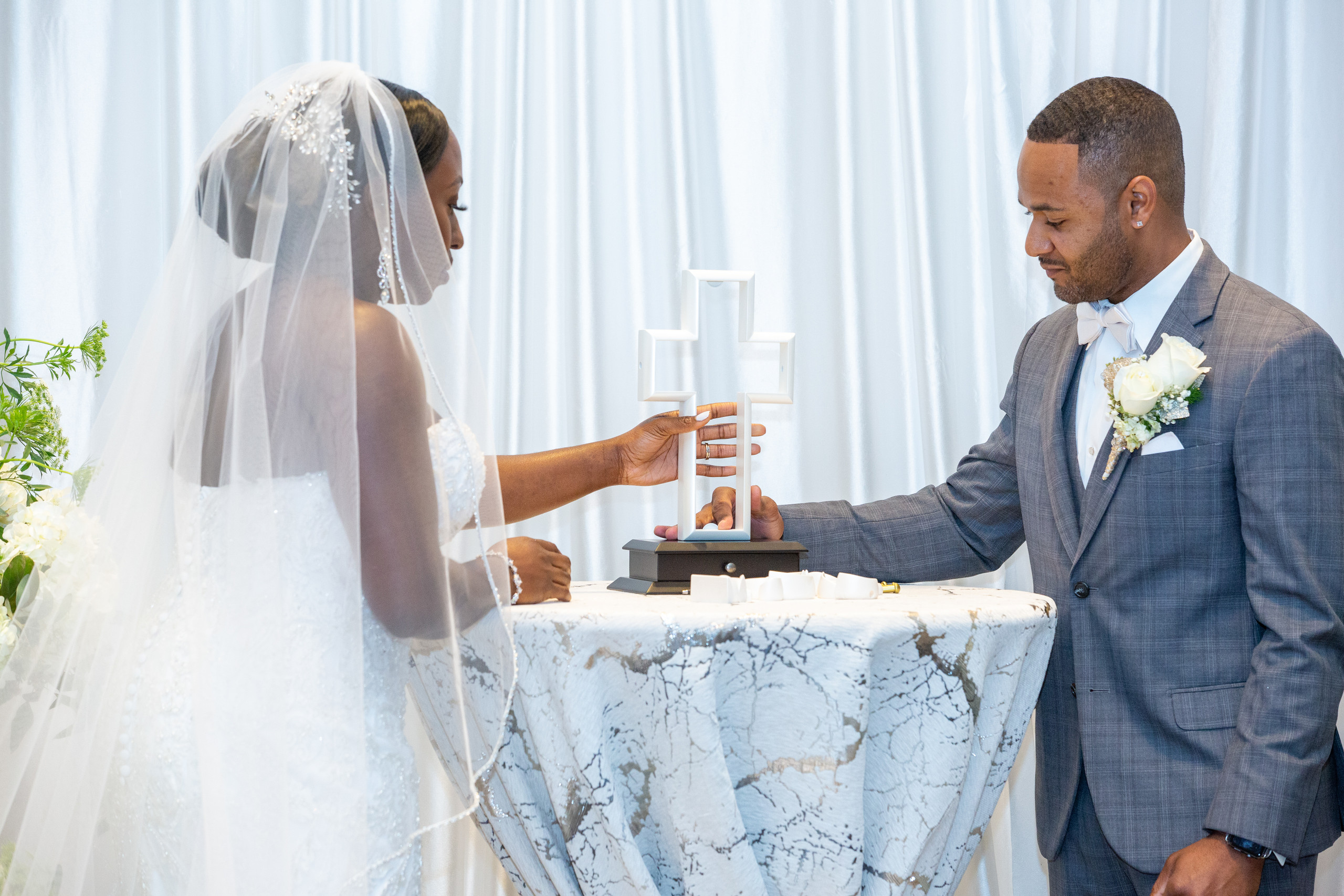 The bride and groom partake in the cross building ceremony during the wedding ceremony at the Hilton Main in Norfolk, Virginia.