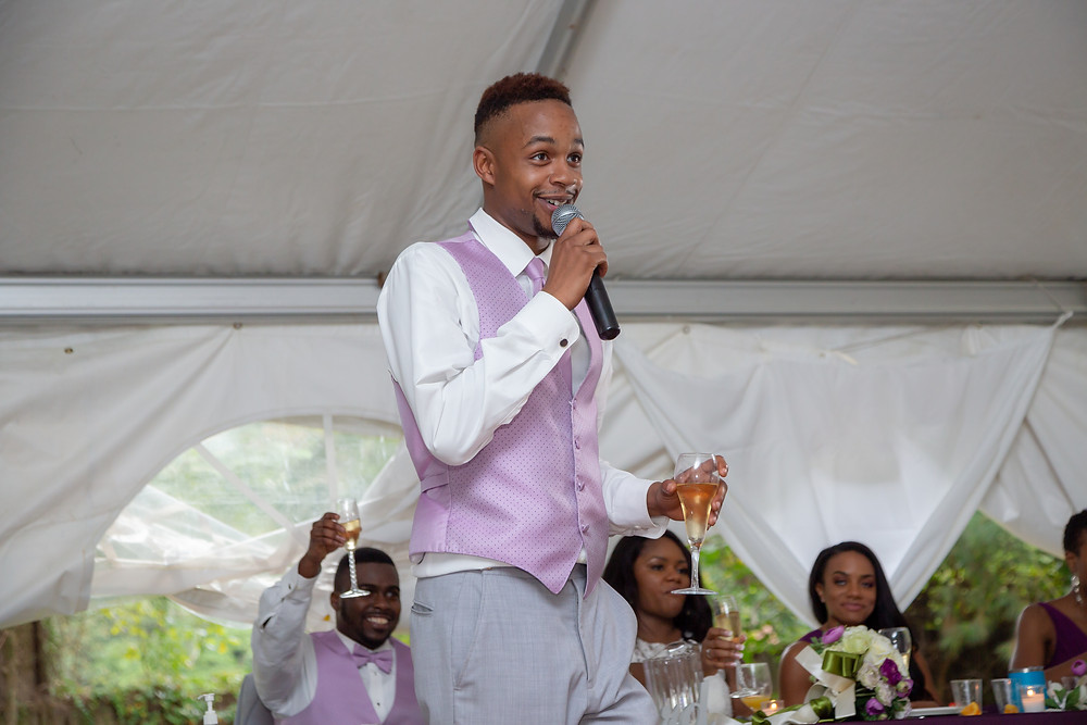 The best man shares a funny story during his speech at the wedding reception in Fairfax, Virginia.