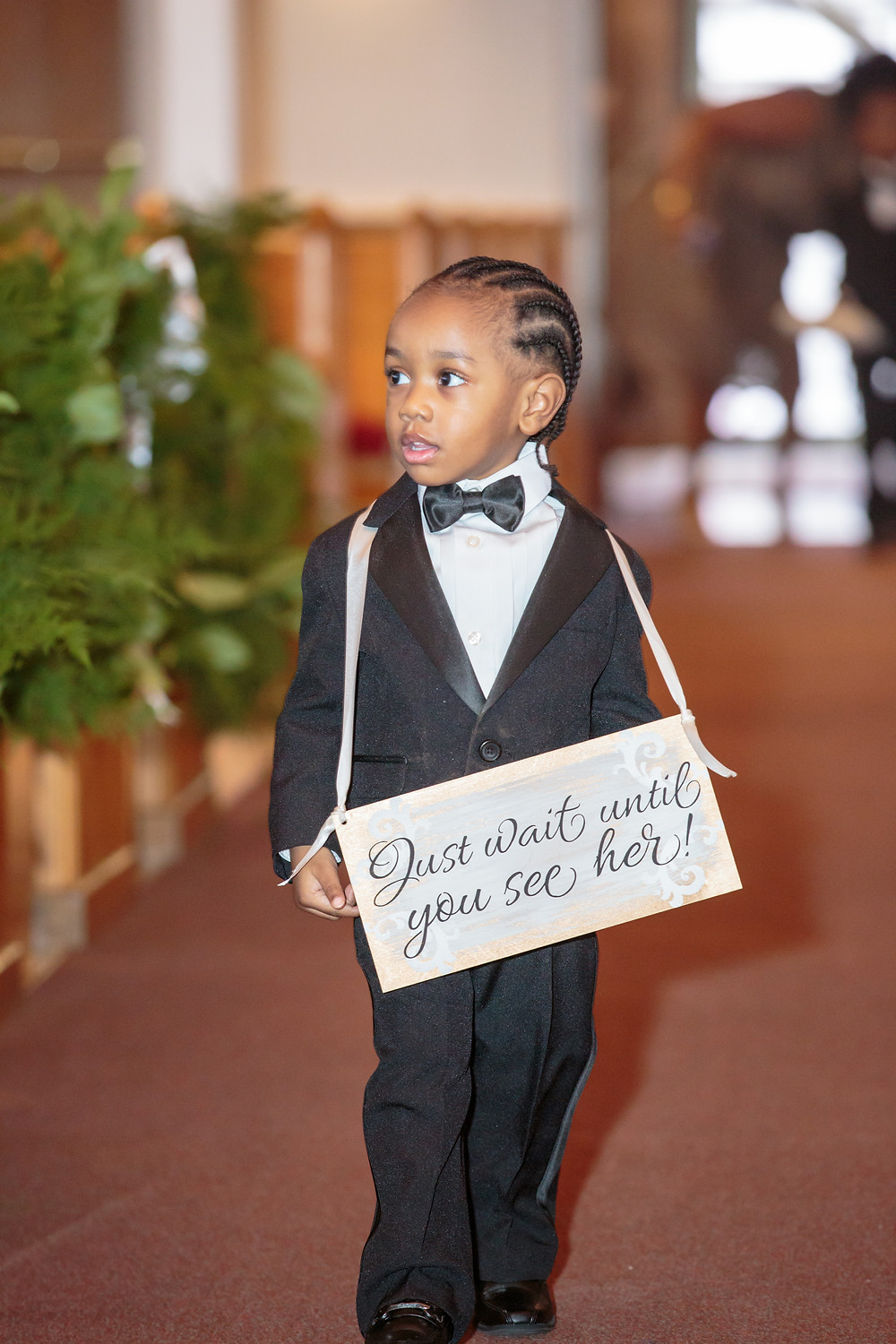 The junior groomsman walking down the isle to the alter at the Alfred Street Baptist Church in Alexandria, Virginia.