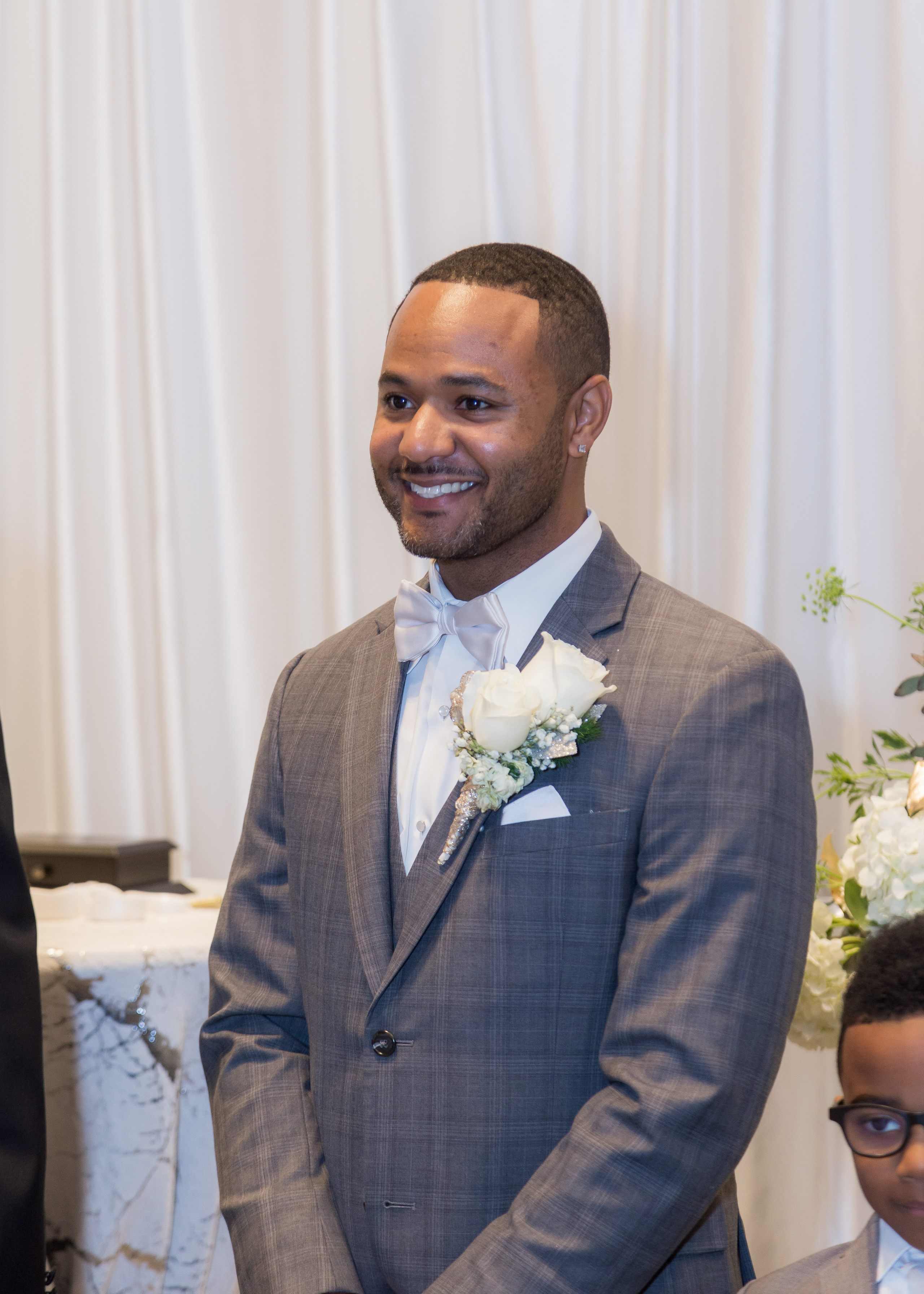 The groom at the alter awaiting his bride during the wedding ceremony at the Hilton Main in Norfolk, Virginia.