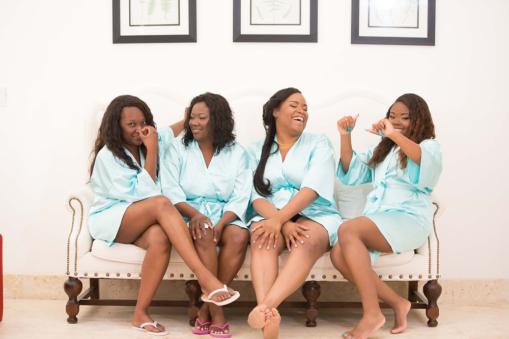 The bridesmaids posing for a portrait before the destination wedding in Punta Cana, Dominican Republic.