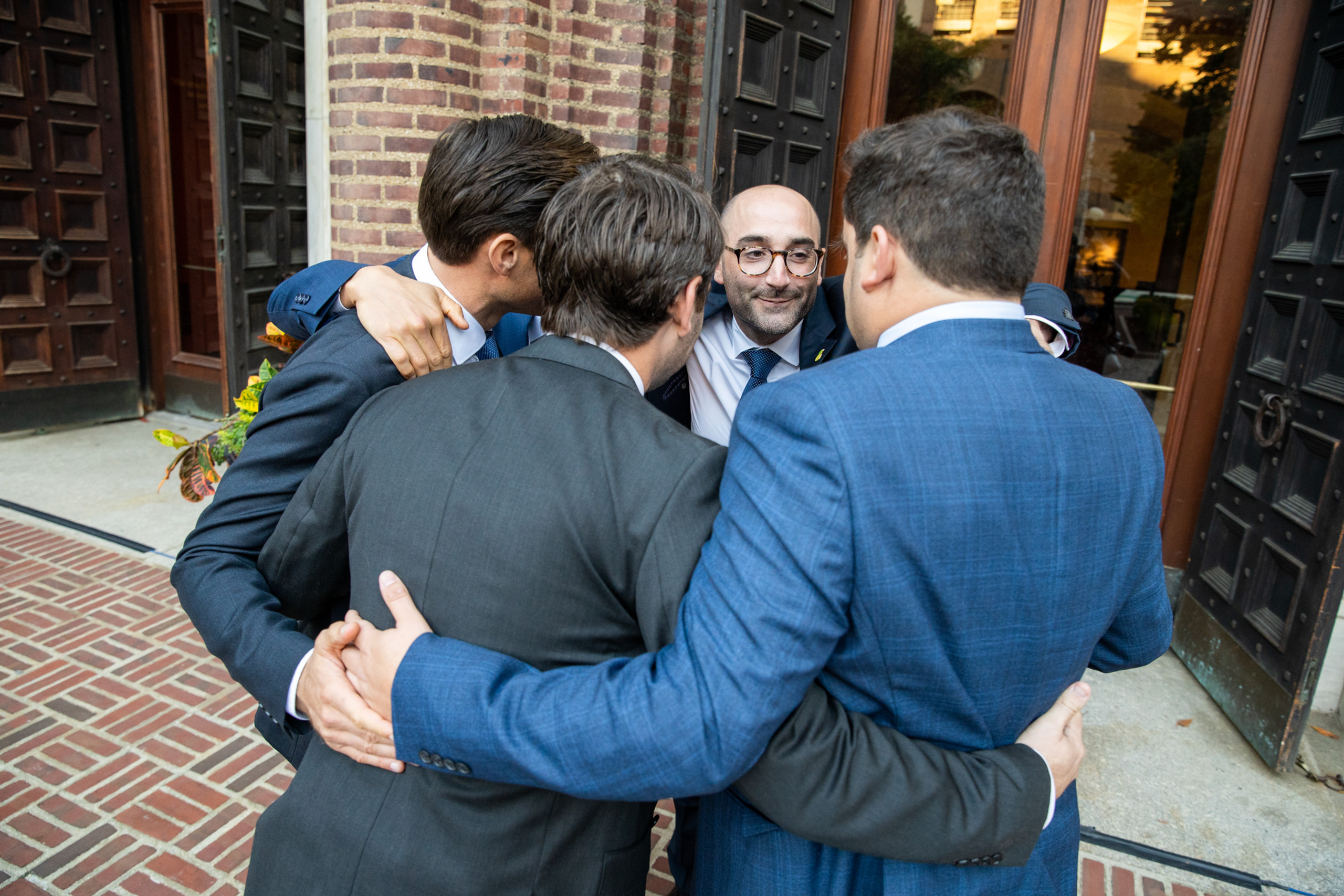 The groom's closest friends huddle up before the wedding ceremony at the Penn Museum in Philadelphia, Pennsylvania.