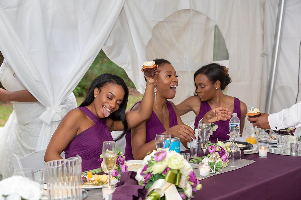 The bridesmaids enjoy the wedding cupcakes during the wedding reception in Fairfax, Virginia.