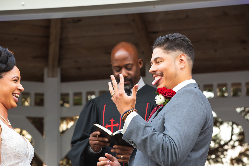 Groom showing off his wedding band during the wedding ceremony at Martin's Crosswinds in Greenbelt, Maryland.