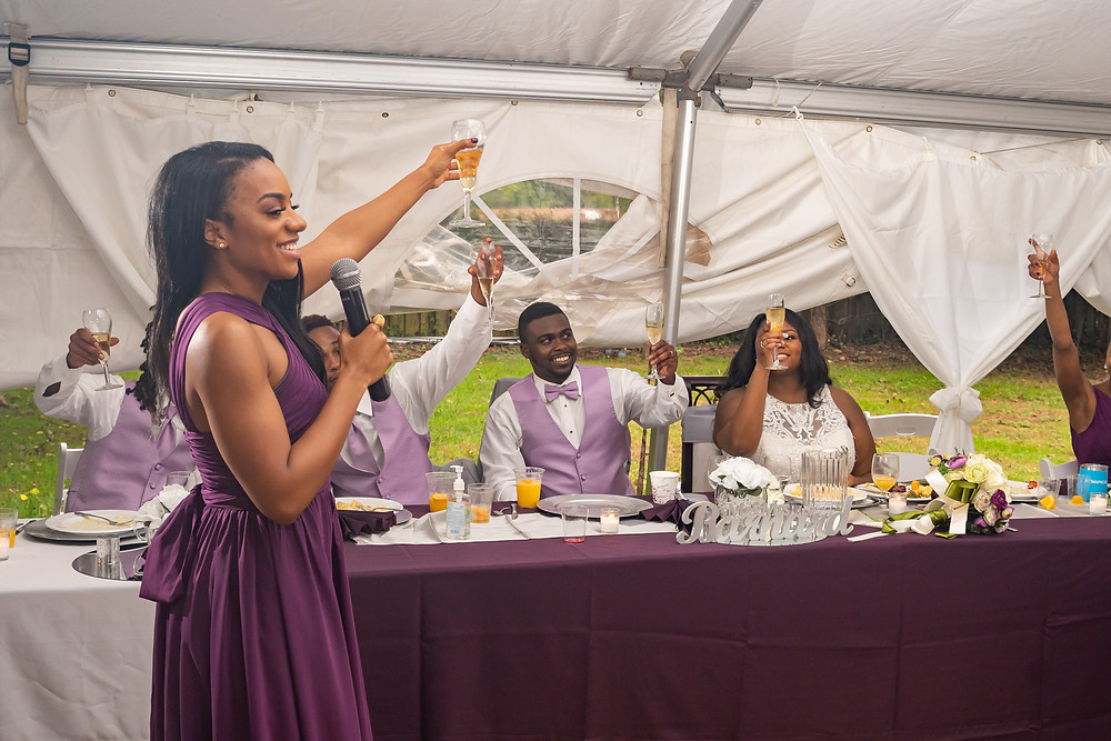 The maid of honor raises a glass to toast the bride and groom during the wedding reception in Fairfax, Virginia.