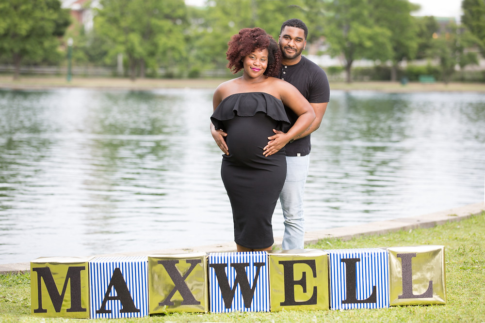 Jennae and Maurice pose for a maternity photo at Byrd Park in Richmond, Virginia.