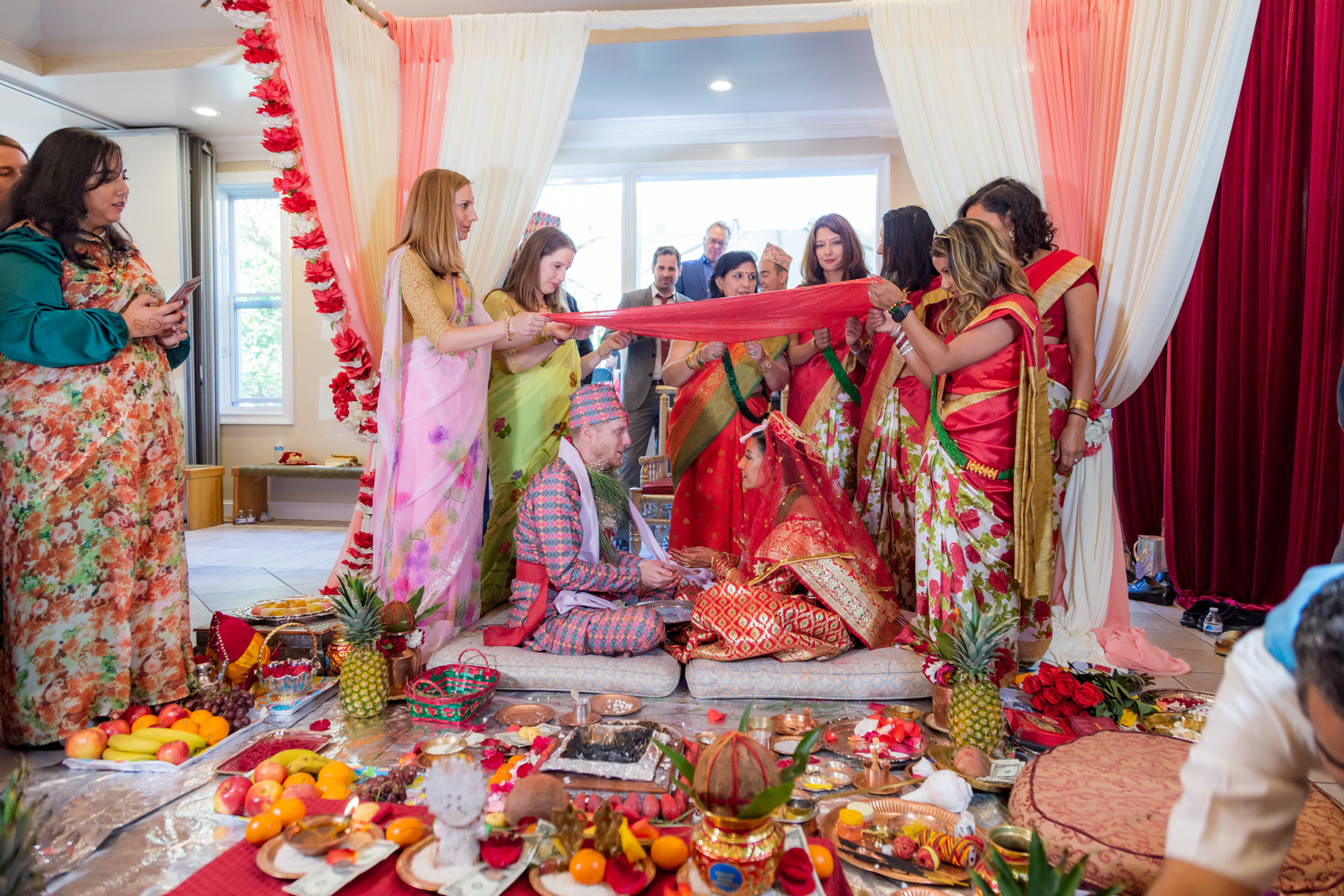 Both families of the bride and groom partake in a ritual during the Hindu Ceremony at the ISKCON of DC in Potomac, Maryland.