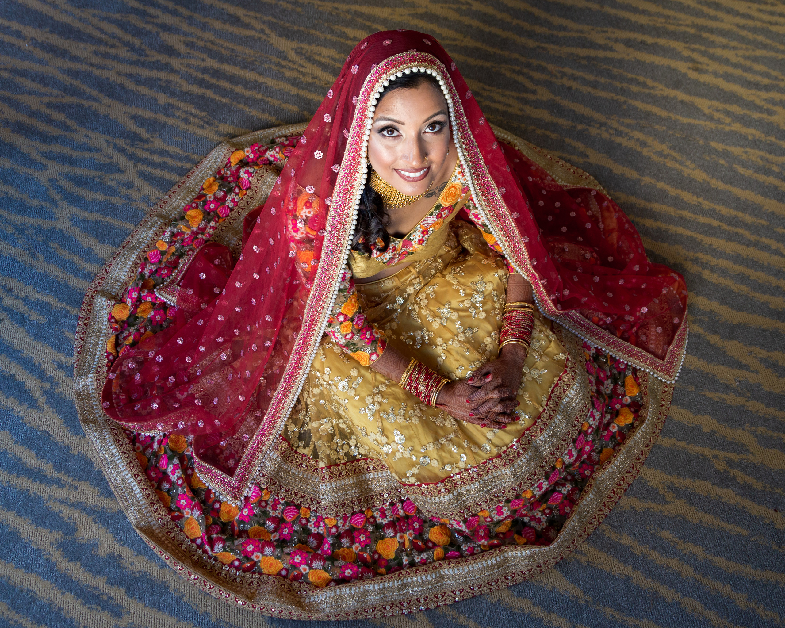 Bridal portrait in her traditional Nepali wedding dress before the wedding ceremony at the Penn Museum in Philadelphia, Pennsylvania.