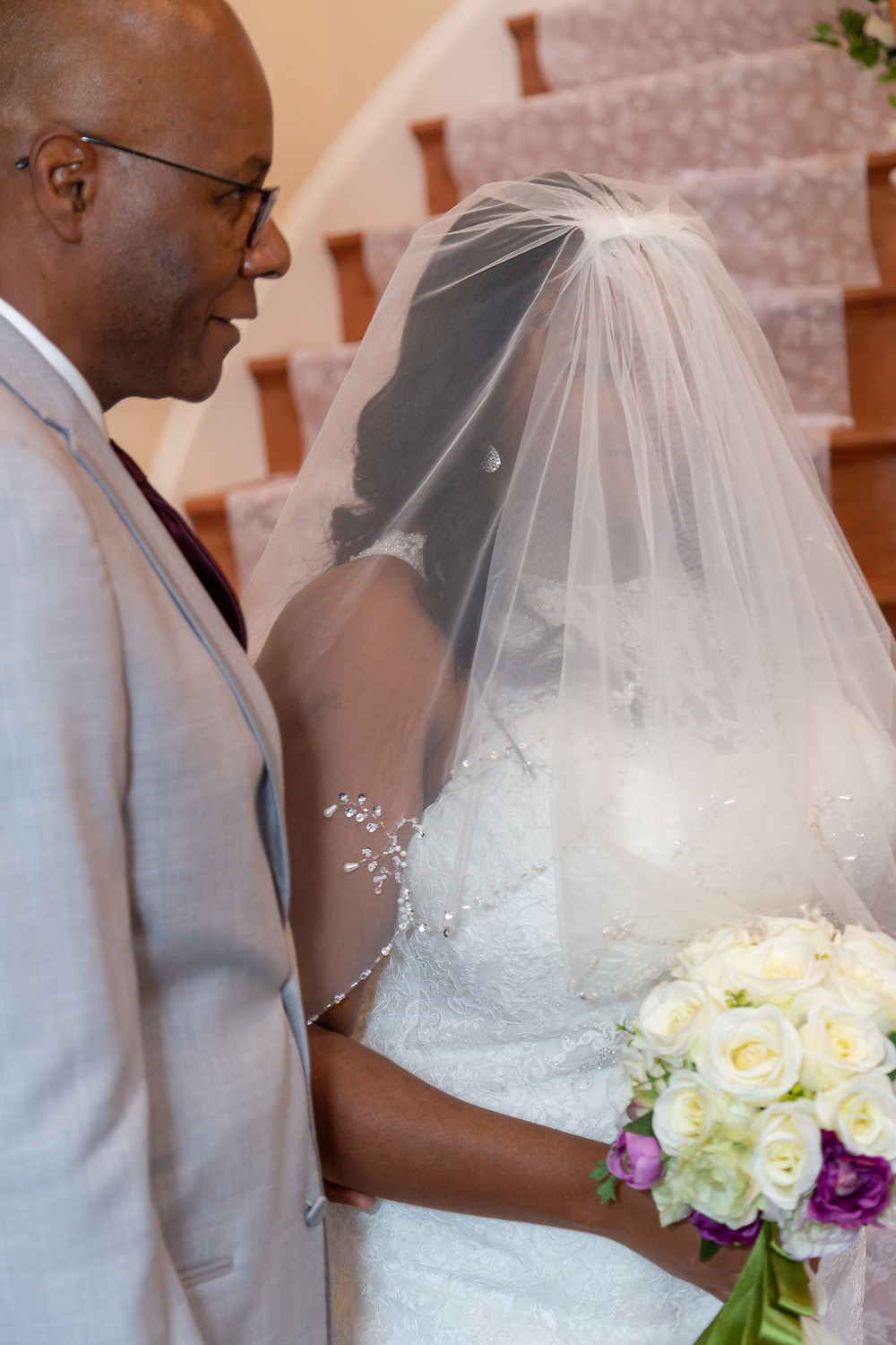 The bride and her father during the wedding ceremony in Fairfax, Virginia.