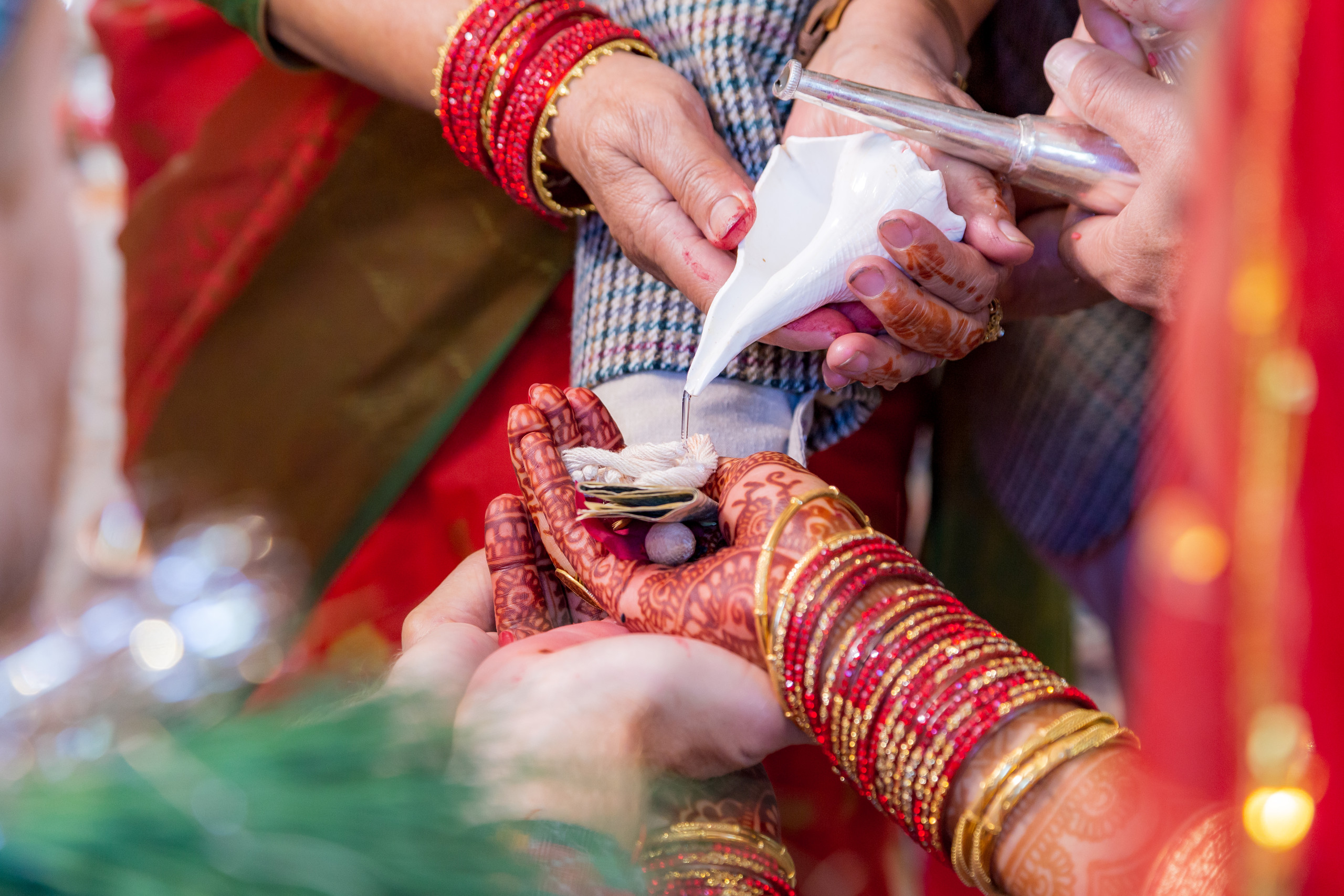 Bride and groom receiving blessings from their family members during the Hindu Ceremony at the ISKCON of DC in Potomac, Maryland.