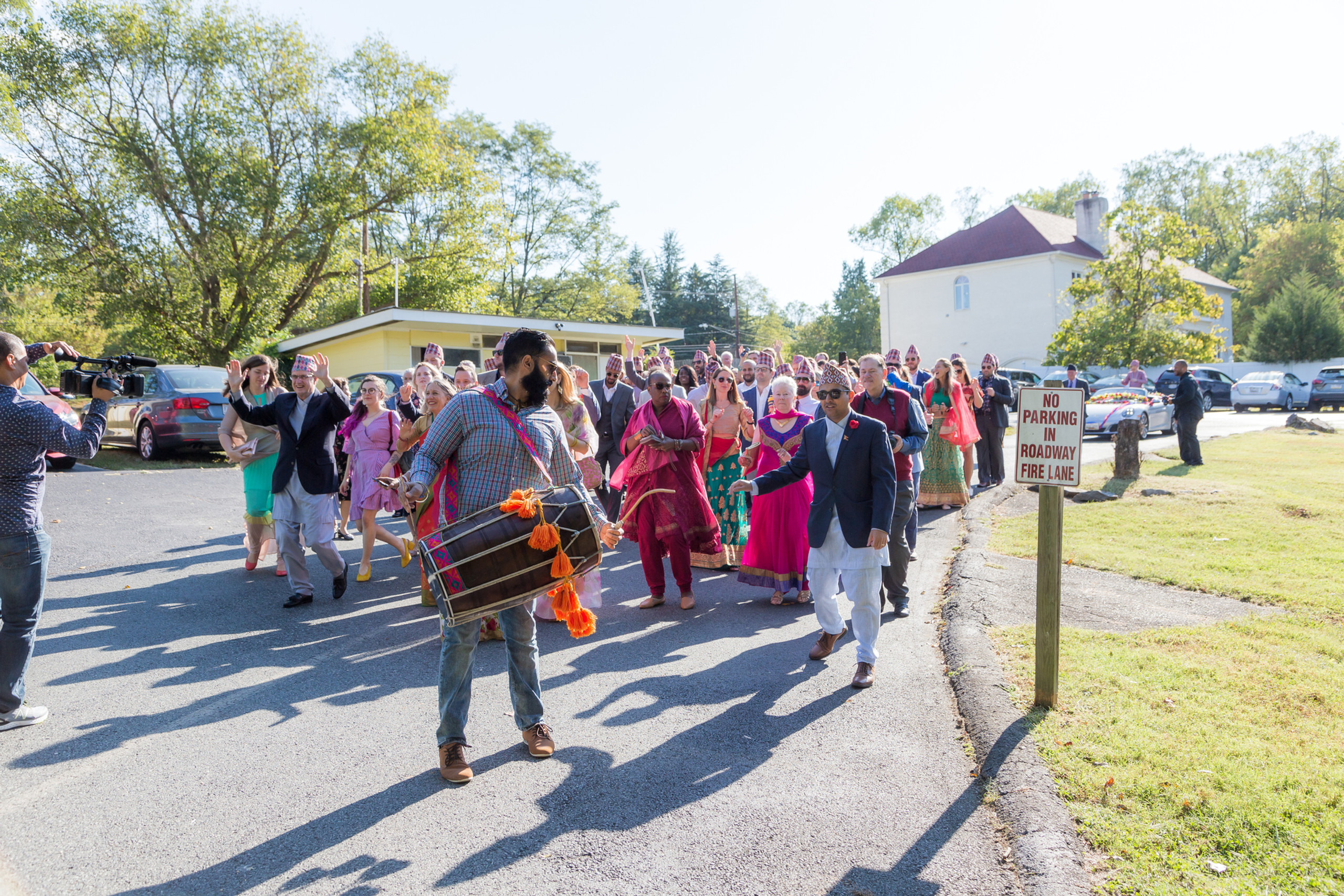 Wedding guests participating in the Janti portion of the Hindu Ceremony at the ISKCON of DC in Potomac, Maryland.