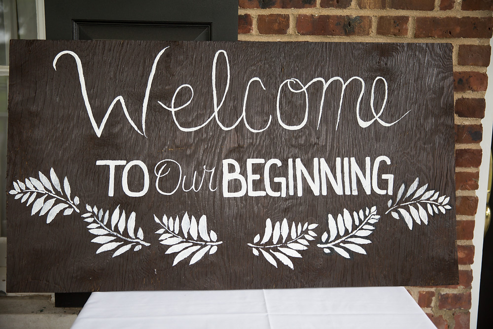 Welcoming sign outside of a wedding venue.