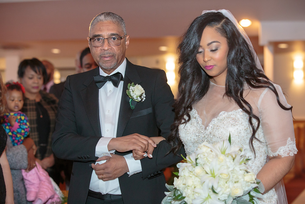 The bride and her father walk down the isle to the alter at the Alfred Street Baptist Church in Alexandria, Virginia