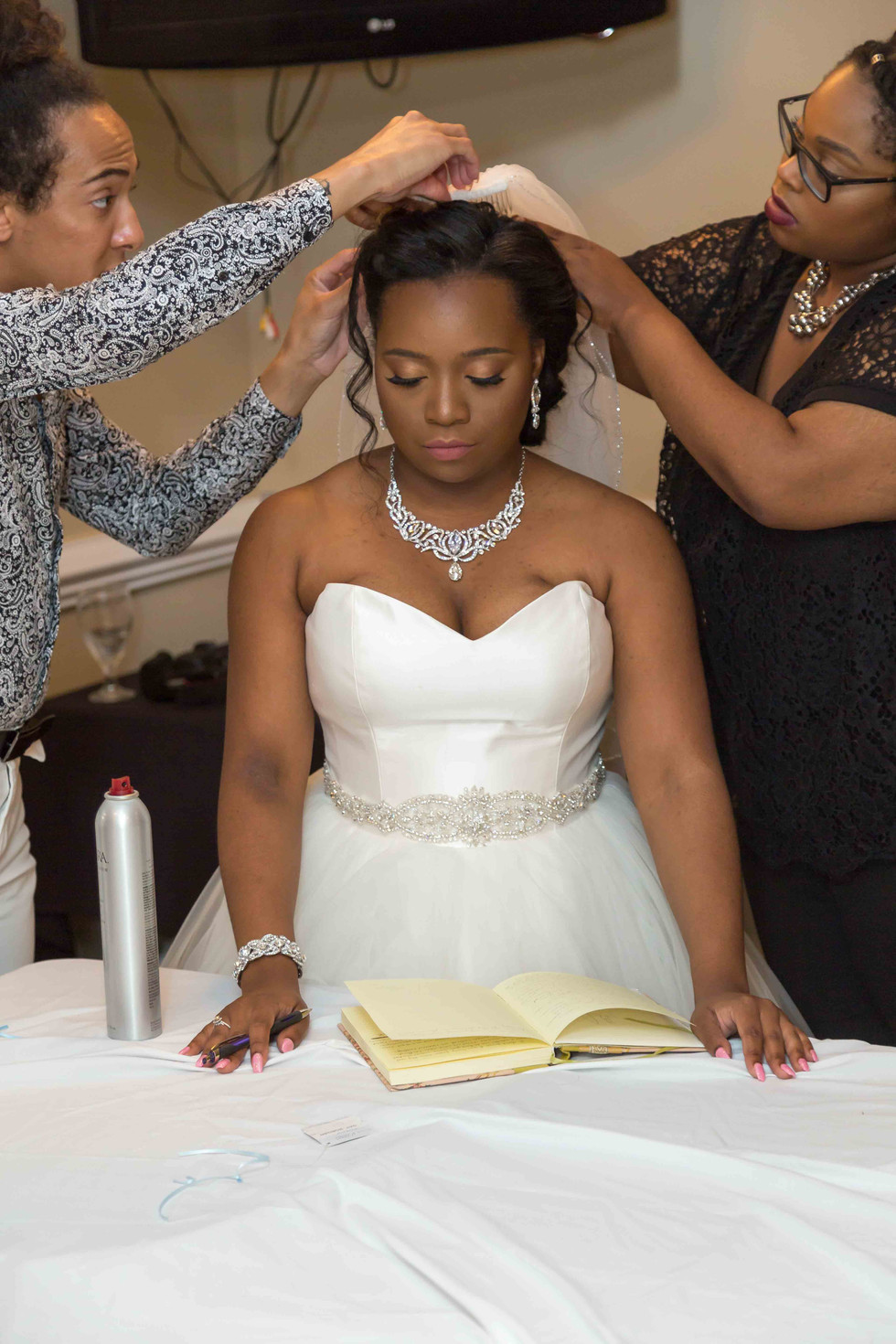 Bride getting her veil put on