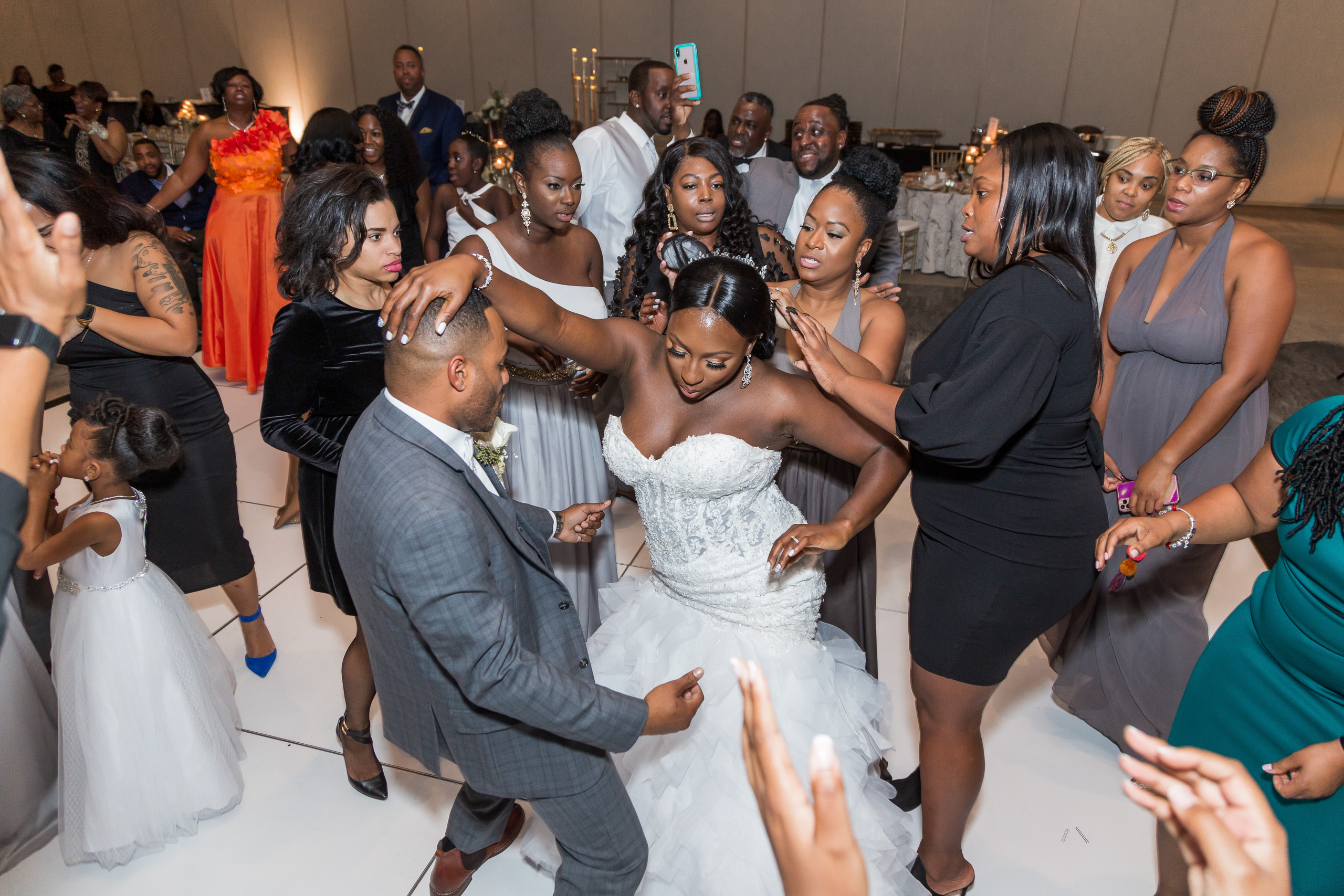 The bride and groom dance on the dancefloor during the wedding reception at the Hilton Main in Norfolk, Virginia.