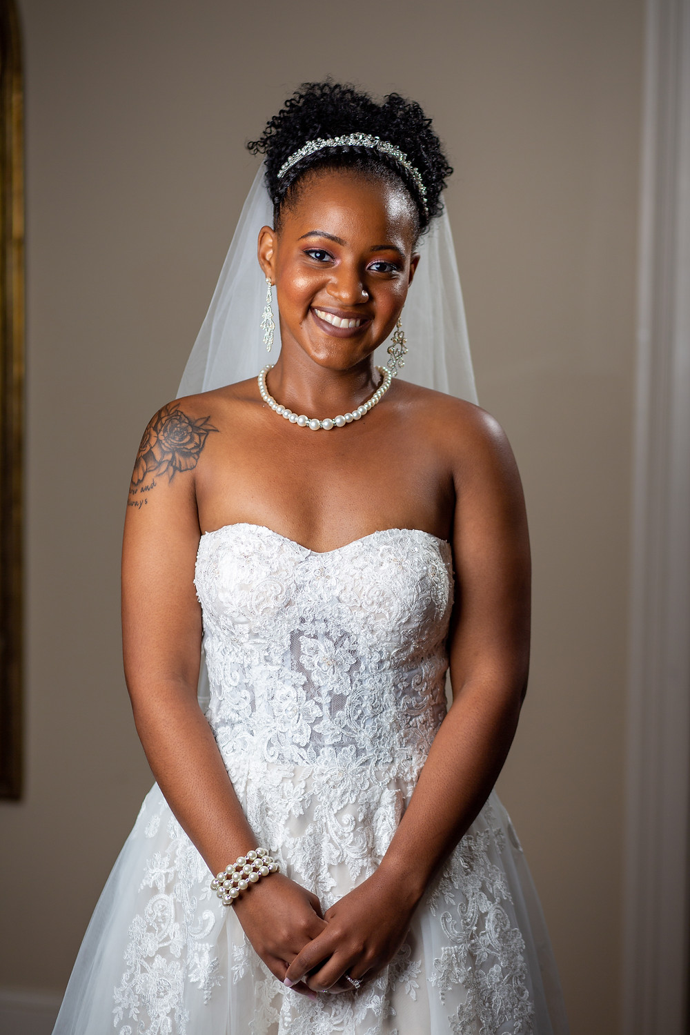 The bride posing for a portrait in her stunning wedding dress at Crosskeys Vineyards in Mt. Crawford, Virginia.