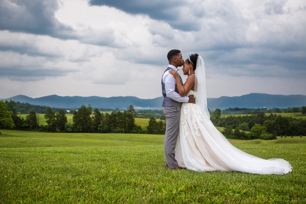 The bride and groom share a special moment after the wedding ceremony at Crosskeys Vineyards in Mt. Crawford, Virginia.