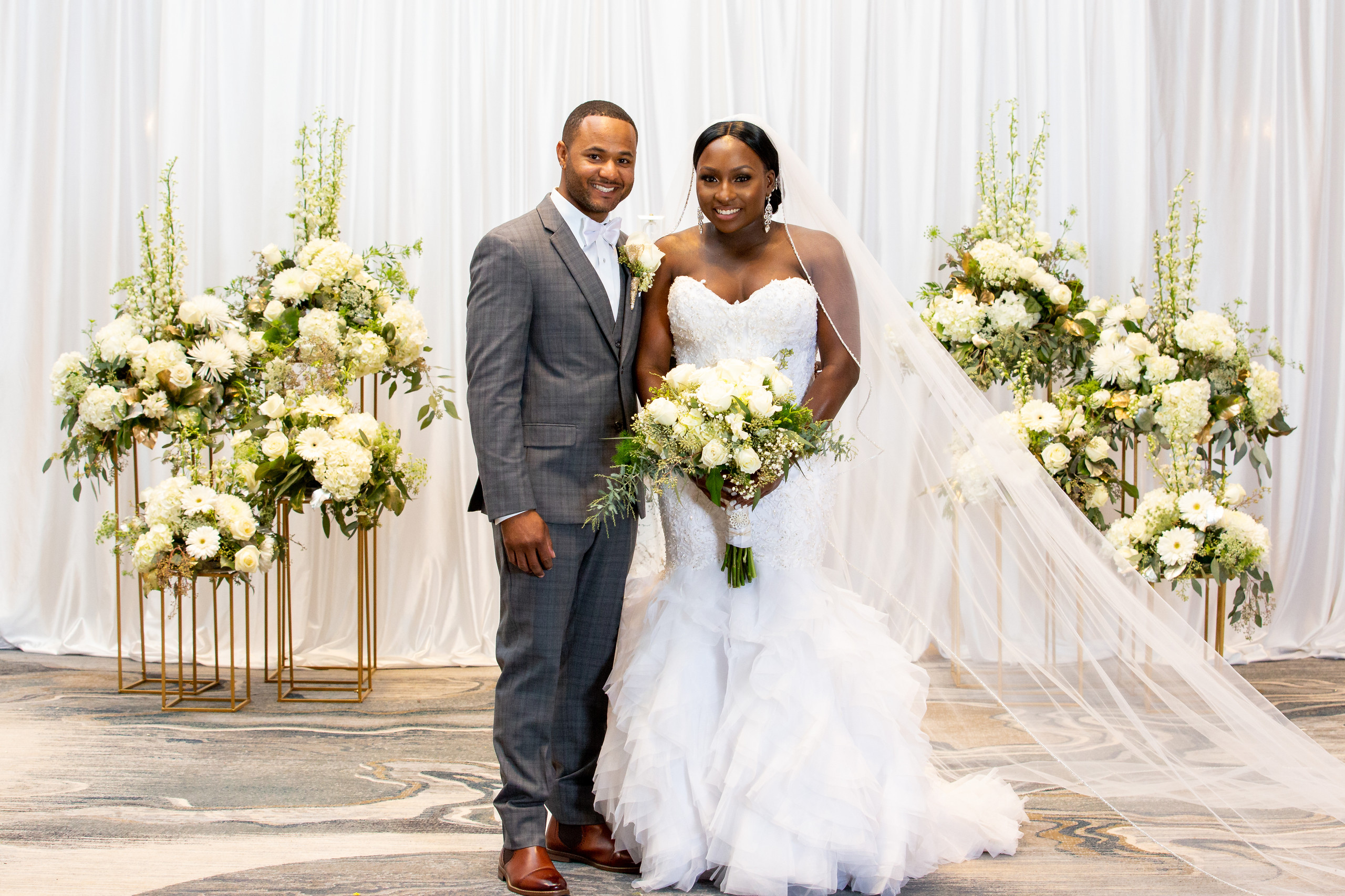 The bride and groom pose for a traditional wedding portrait during the wedding ceremony at the Hilton Main in Norfolk, Virginia.