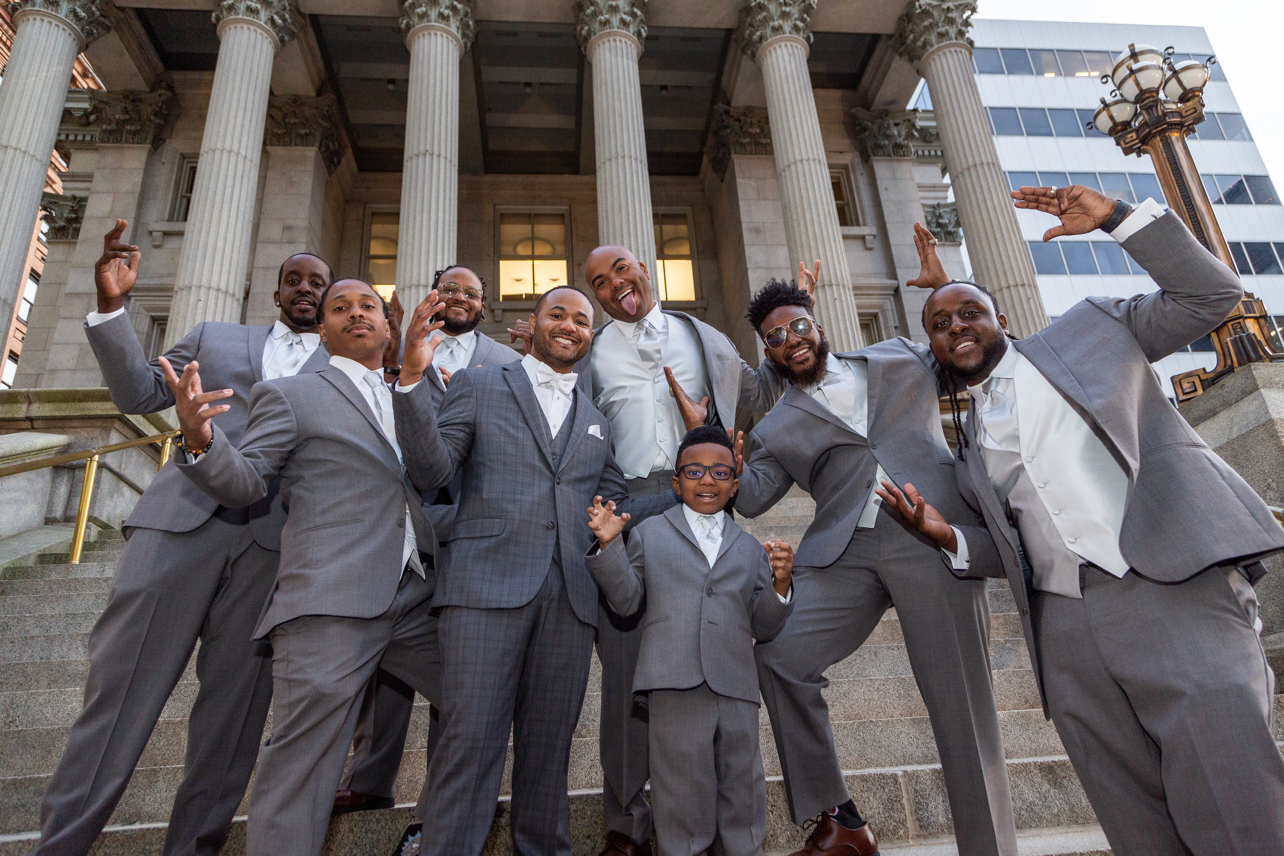 The groom and his groomsmen pose for a fun pre-wedding portrait before the wedding at the Hilton Main in Norfolk, Virginia.