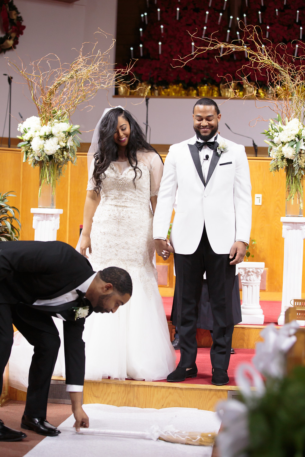 The bride and groom are presented as Mr. and Mrs. for the very first time during the wedding ceremony at the Alfred Street Baptist Church in Alexandria Virginia.