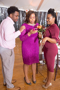 Guests reviewing a recent picture after the the bouquet toss.
