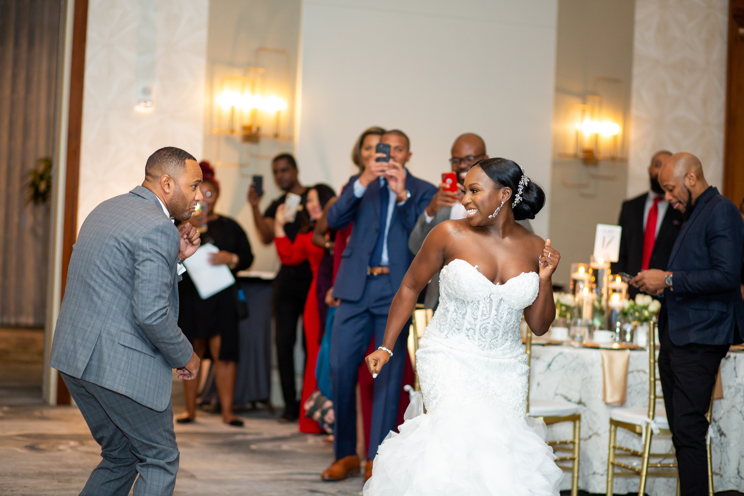 The bride and groom make their grand entrance at the beginning of the wedding reception at the Hilton Main in Norfolk, Virginia.