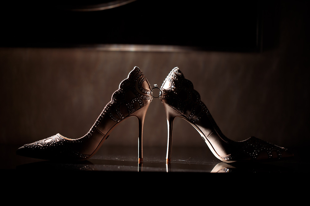 The wedding ring and brides shoes in a dramatic lighting setup at the Westin Alexandria.