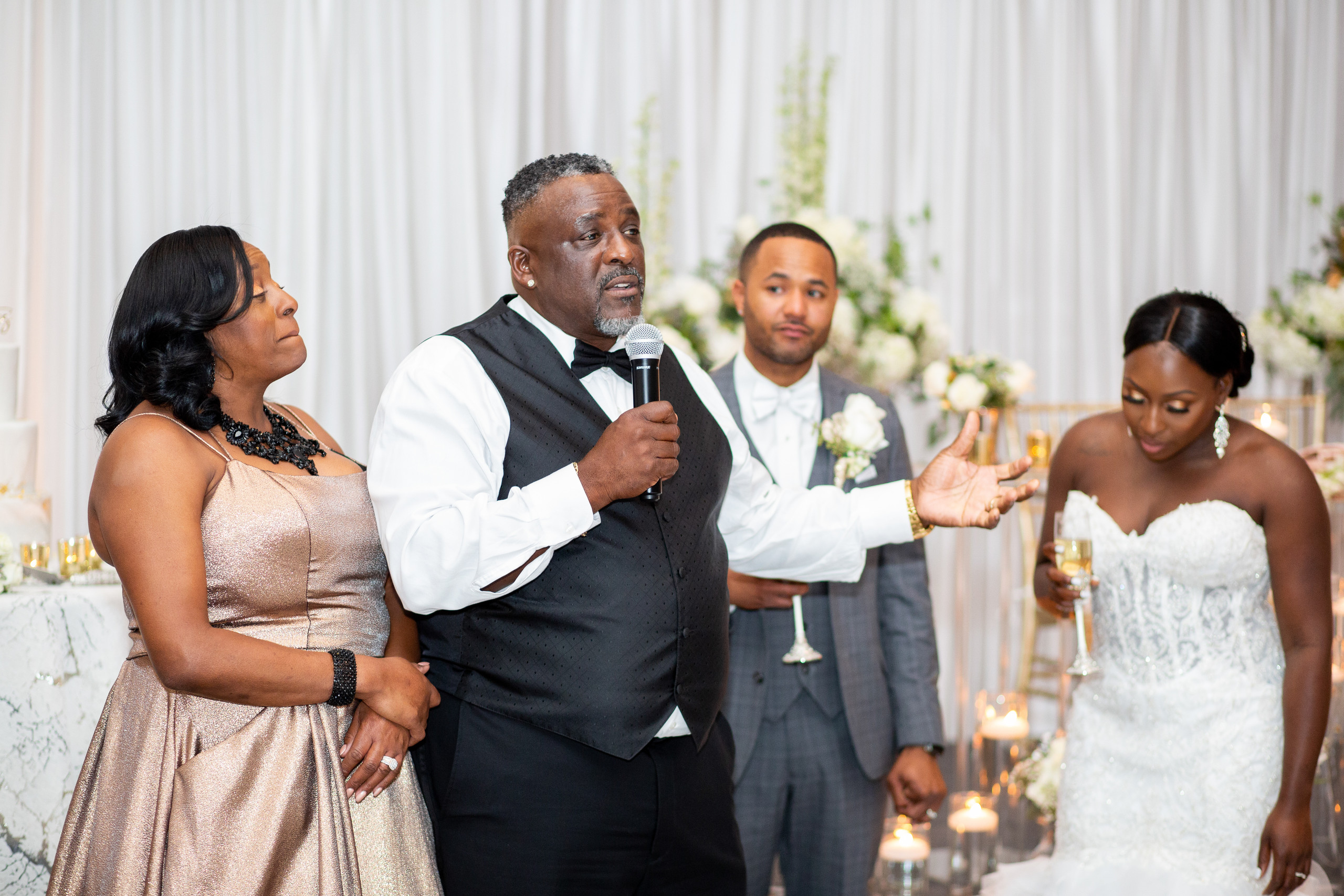The parents of the bride welcome their new son-in-law with a toast during the wedding reception at the Hilton Main in Norfolk, Virginia.