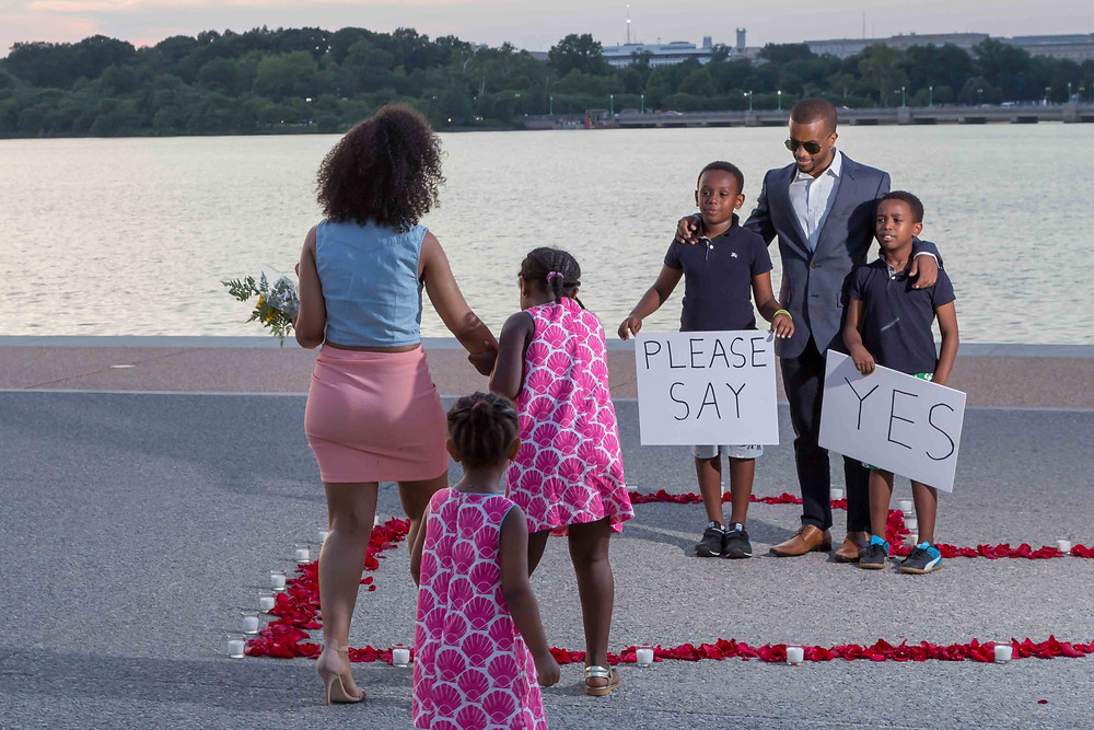 Kaleab stands with Essete's family as he asks the question in front of a big crowd at the Jefferson Memorial.