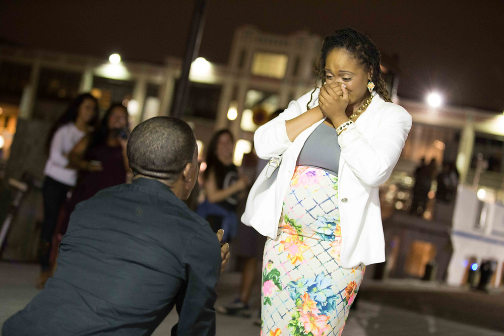 A proposal at Old Town Alexandria leaves this bride-to-be stunned and overjoyed.