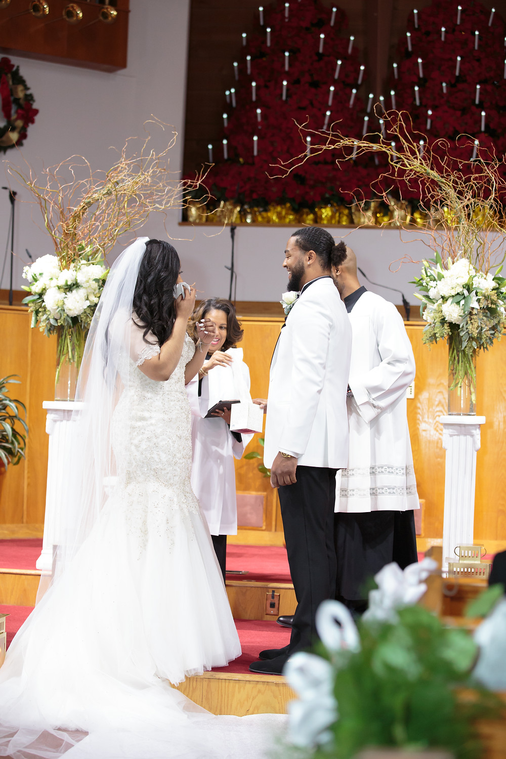 The bride sheds some tears during the vows portion of the wedding ceremony at the Alfred Street Baptist Church in Alexandria Virginia.