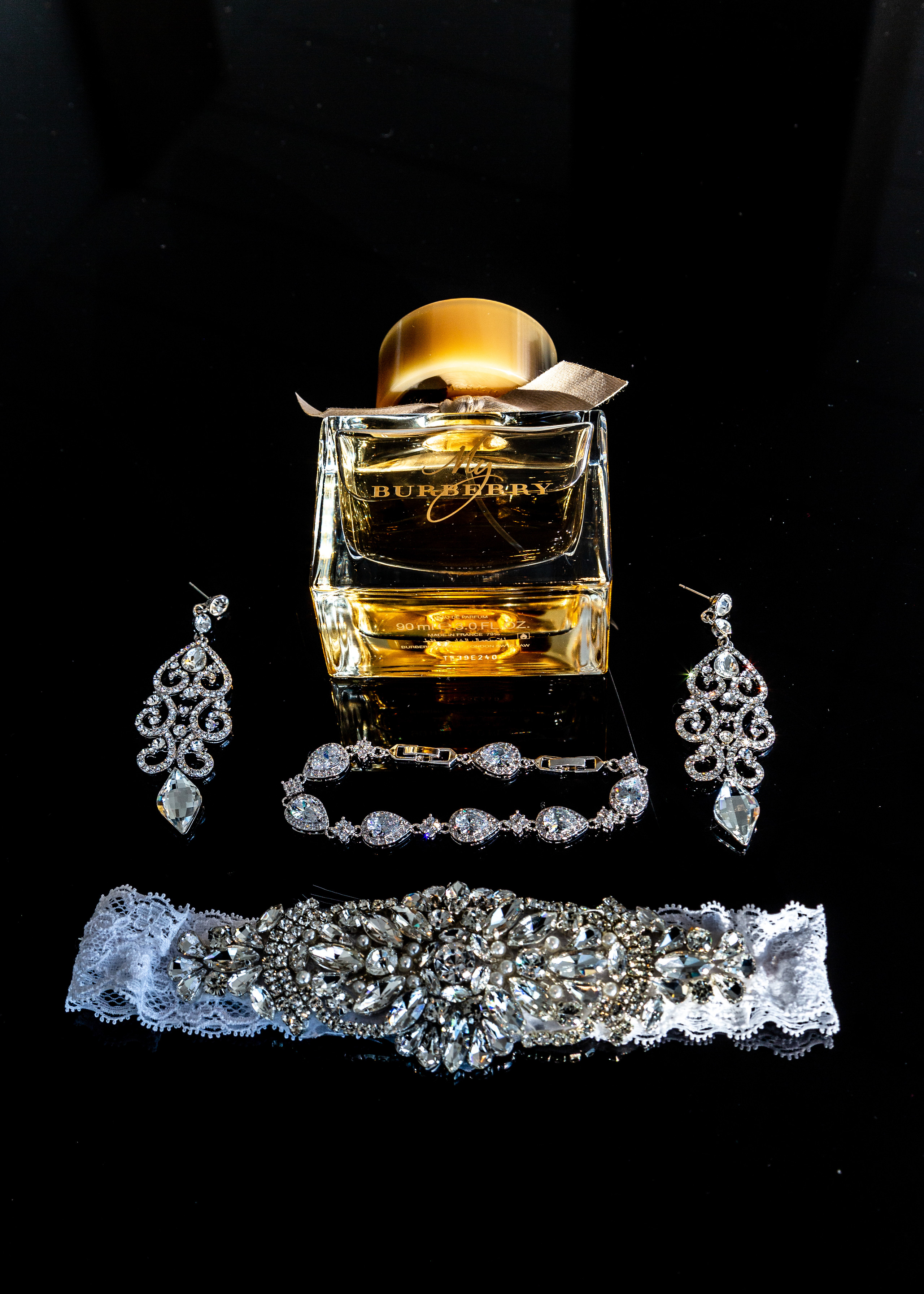 Wedding detail of the bride's wedding jewelry and perfume before the wedding at the Hilton Main in Norfolk, Virginia.