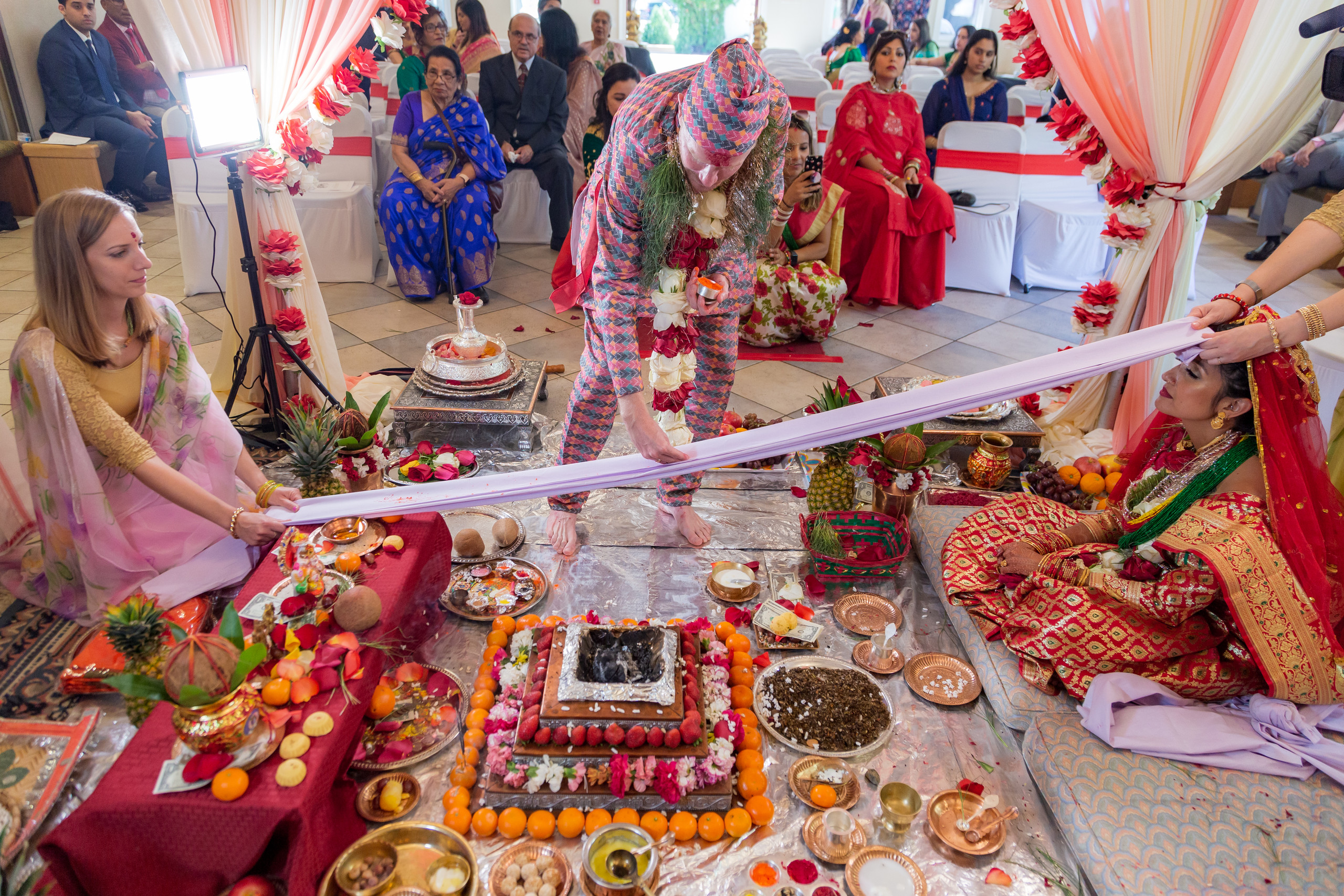 The groom performing the Sindoor Mangal Sutra portion of the Hindu Ceremony at the ISKCON of DC in Potomac, Maryland.