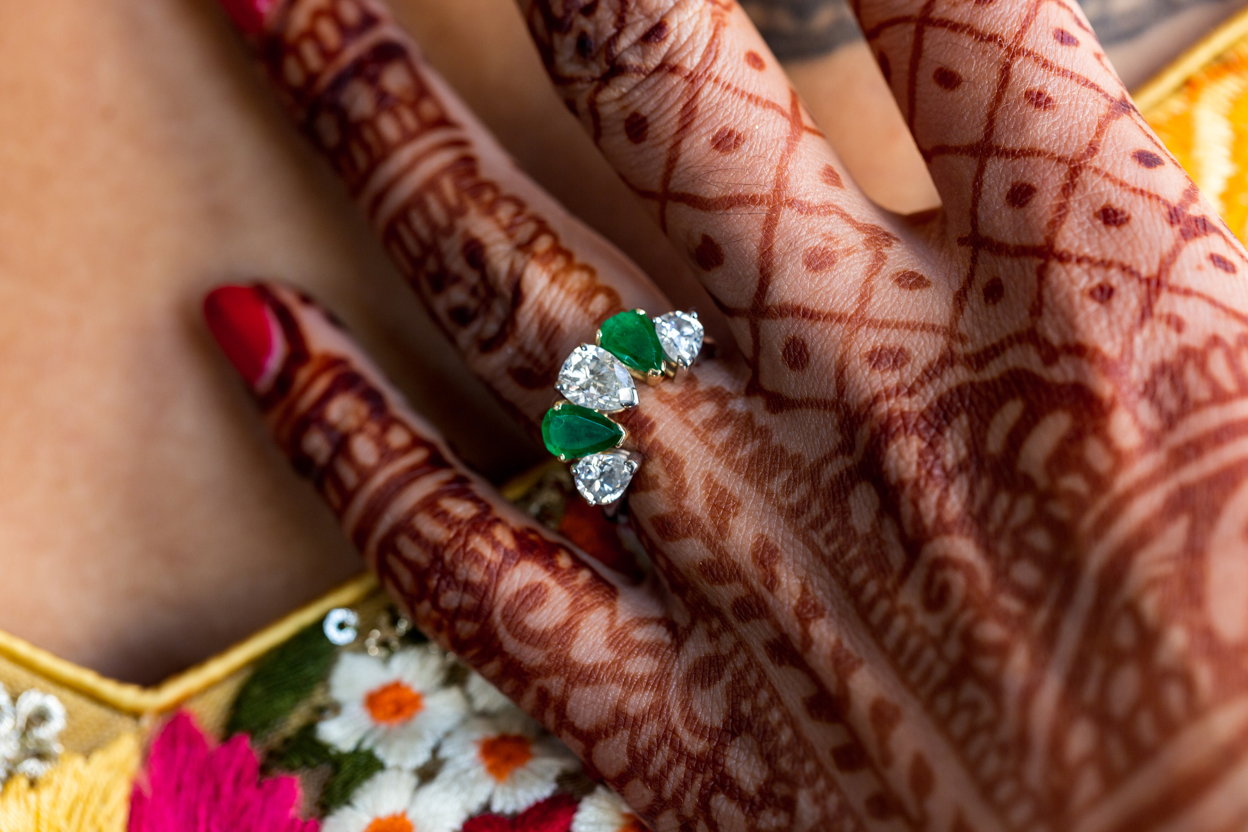 The bride's jade and diamond wedding right with her henna tattoo before the wedding ceremony at the Penn Museum in Philadelphia, Pennsylvania.