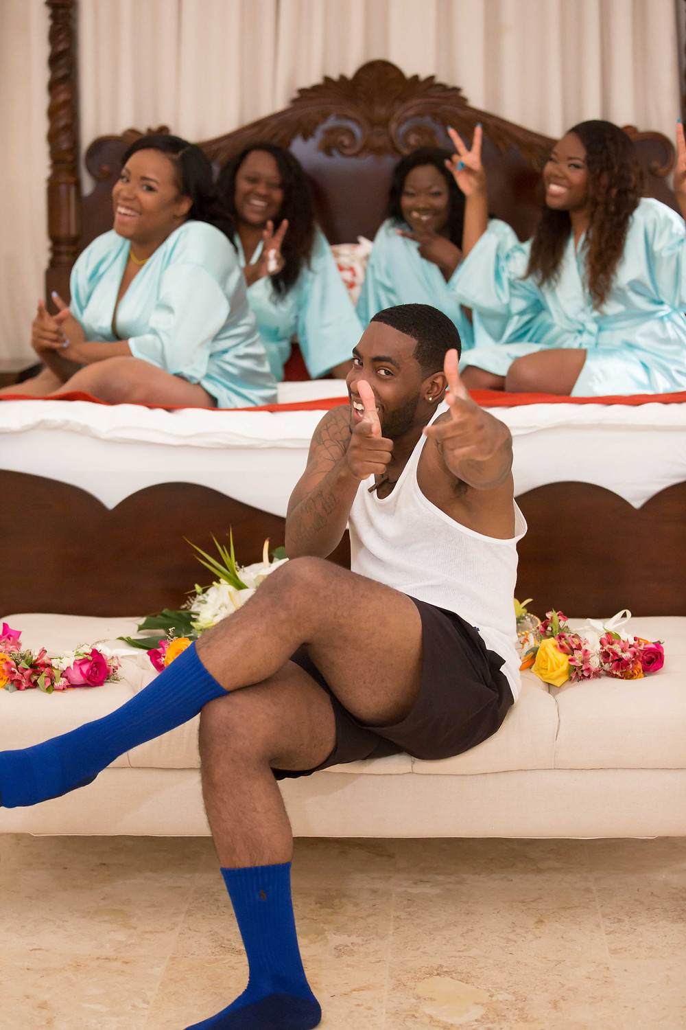 The groom having some fun with the bridesmaids before the destination wedding in Punta Cana, Dominican Republic.