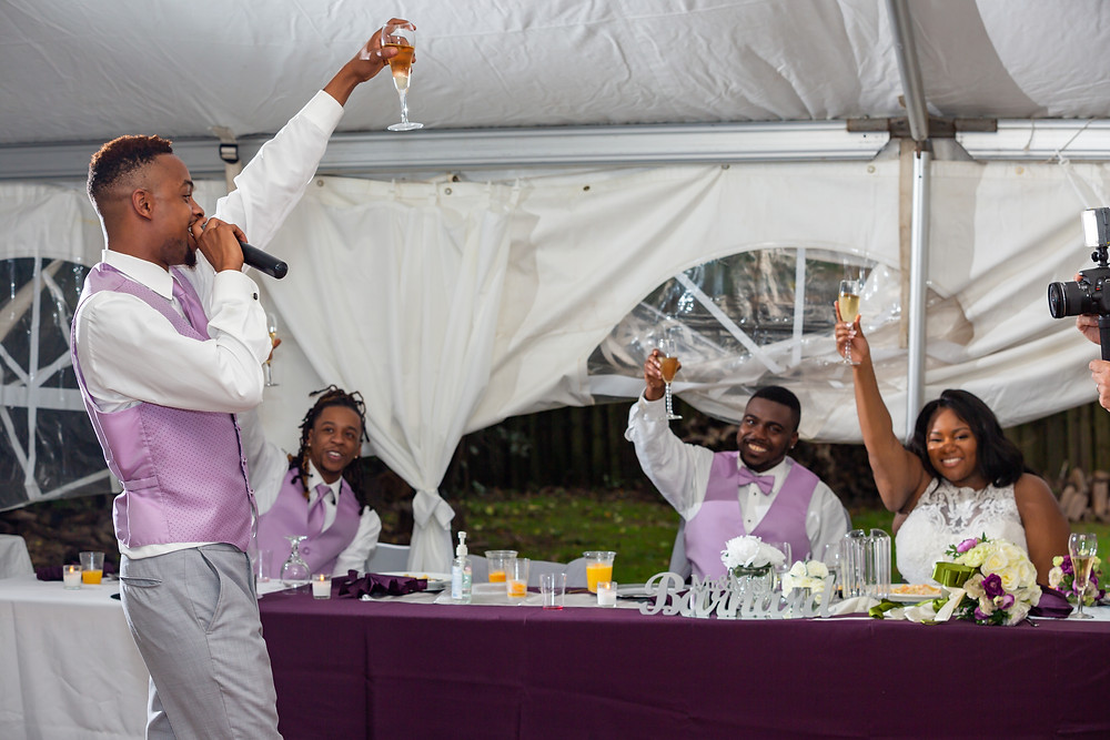 The best man raises a toast for the couple during the wedding reception in Fairfax, Virginia.