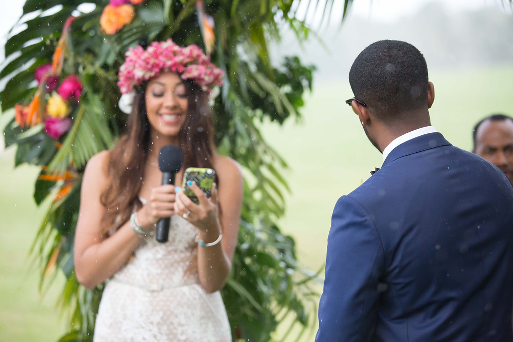 The bride begins to read her vows as it begins to rain during the destination wedding in Punta Cana, Dominican Republic.