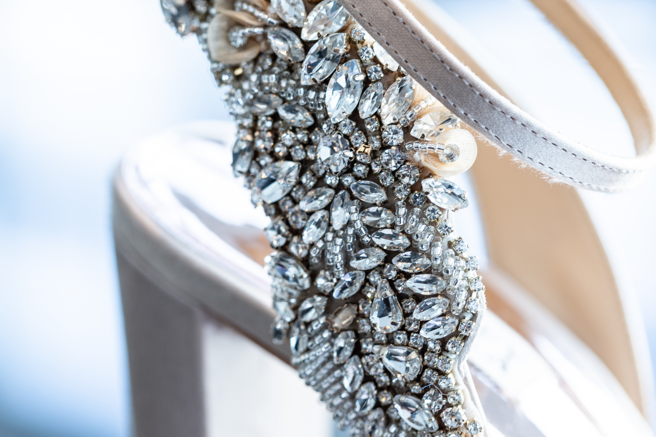 Detail of the brides shoes before the wedding at the Hilton Main in Norfolk, Virginia.