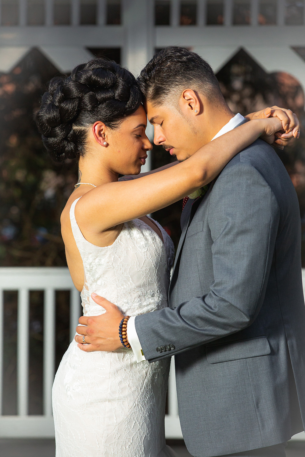 Bride and groom posing for a formal portrait after the wedding ceremony at Martin's Crosswinds in Greenbelt, Maryland.